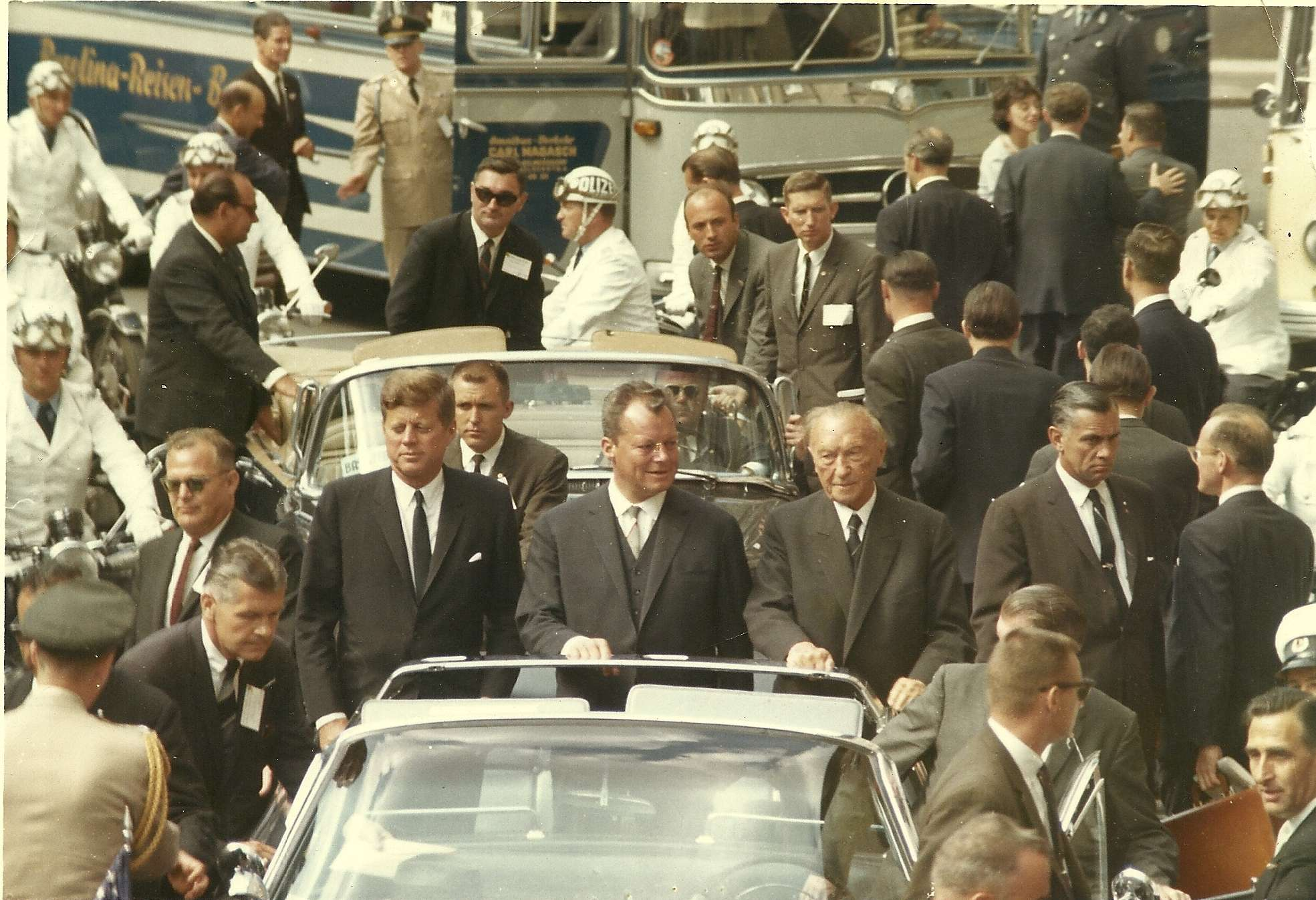 Berlin, West Germany, June 1963: Special Agents Win Lawson (REAR RIGHT) and Jerry Blaine (LEFT behind JFK) worked nearly a dozen motorcades during President KennedyÕs trip to Europe in June 1963.