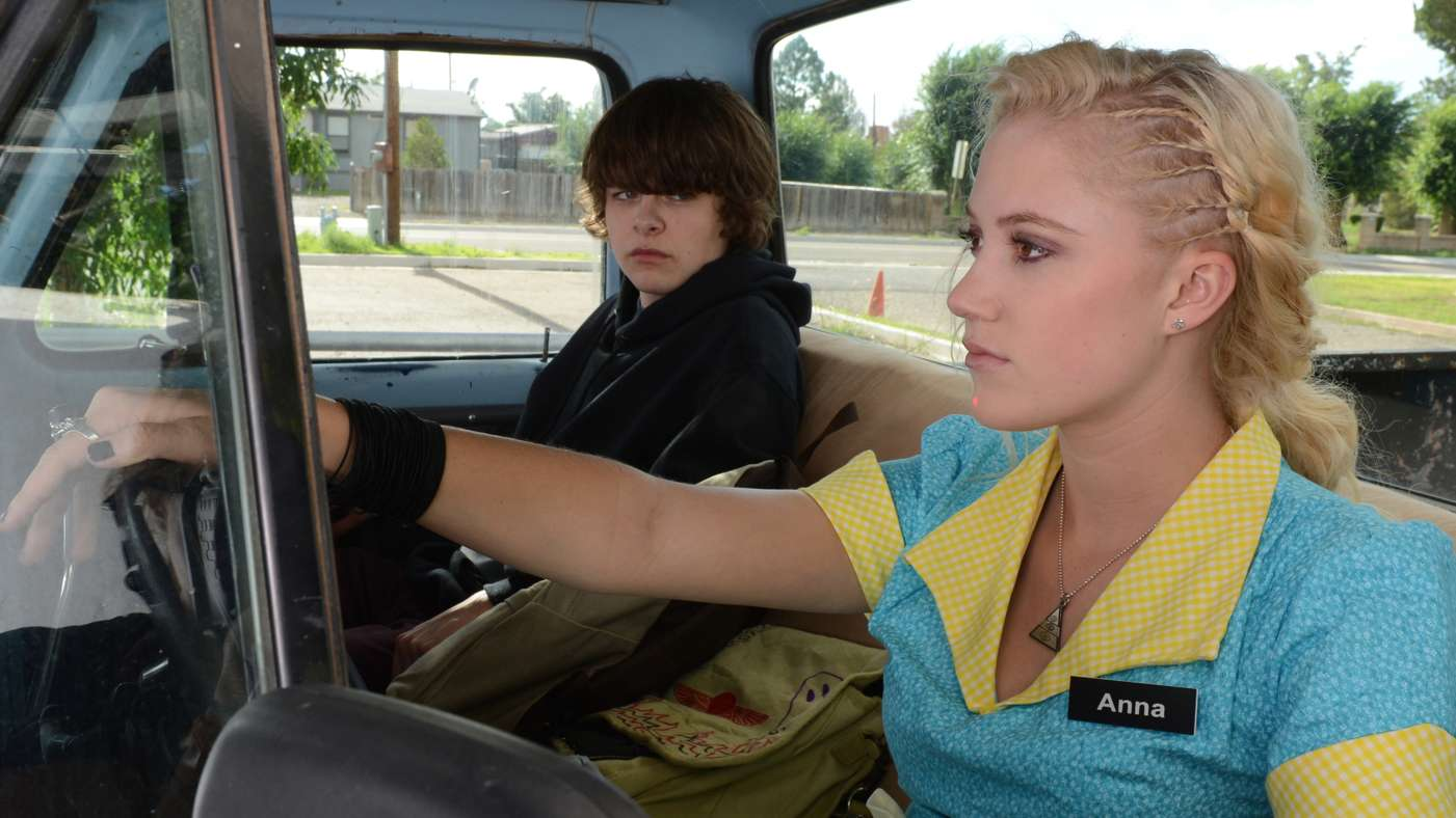 (L-R) BRENDAN MEYER and MAIKA MONROE star in the action thriller THE GUEST, opening in September.